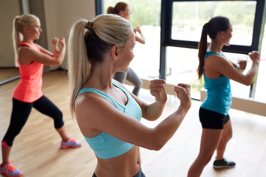 group of women working out martial arts in gym
