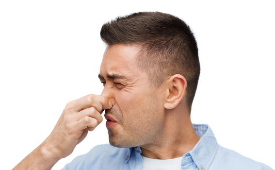 man wrying of unpleasant smell