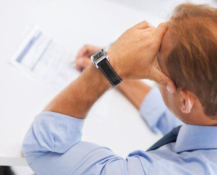 stressed man filling tax form