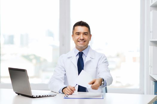 happy doctor with prescription and laptop