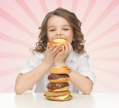 happy little girl eating junk food