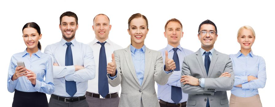 group of happy businesspeople showing thumbs up