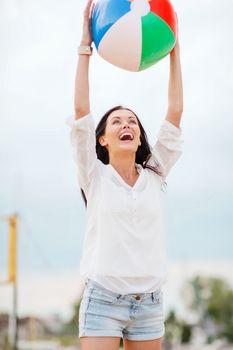 girl playing ball on the beach