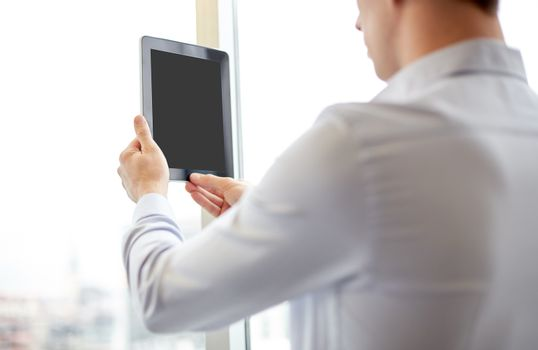 business, technology, internet and people concept - businessman looking to blank tablet pc computer screen at office