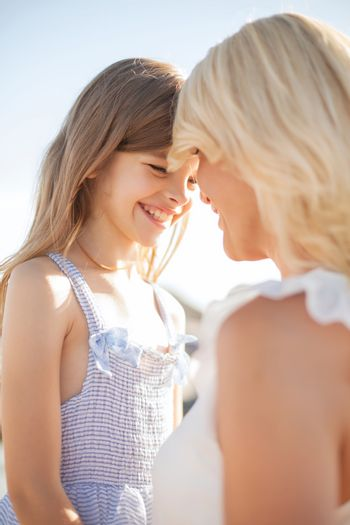 summer holidays, family, children and people concept - happy mother and child girl