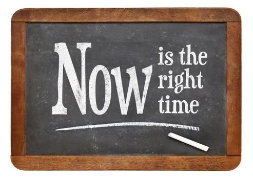 Now is the right time- motivational phrase on a vintage slate blackboard