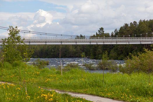 Suspension bridge over the River Niva Kandalaksha city. Russia
