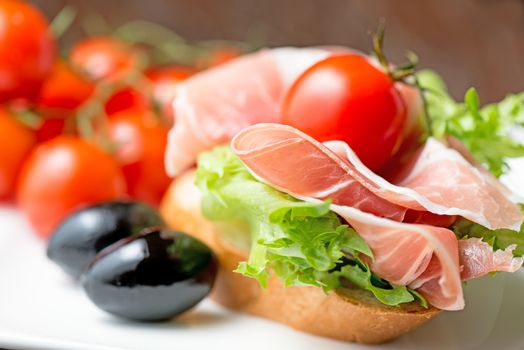 thin slices of prosciutto on plate