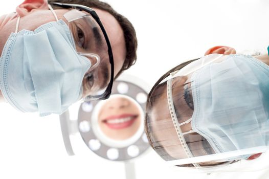 Dentist and assistant from low angle
