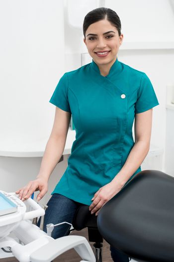 Female assistant seated in dental office