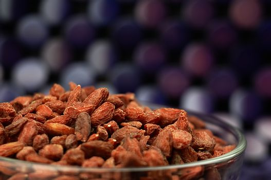 Goji berries in a bowl on the table.