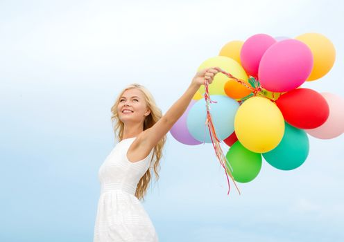 summer holidays, celebration and lifestyle concept - beautiful woman with colorful balloons outside