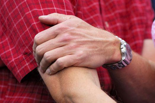 Closeup of man massaging elbow .