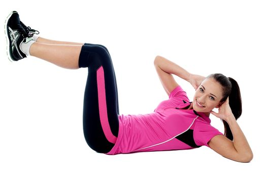 Young woman doing crunches