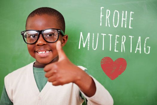 Cute pupil showing thumbs up against green