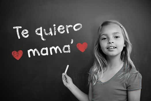 Spanish mothers day message against schoolchild with blackboard