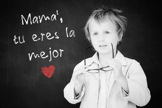 Schoolchild with blackboard against spanish mothers day message