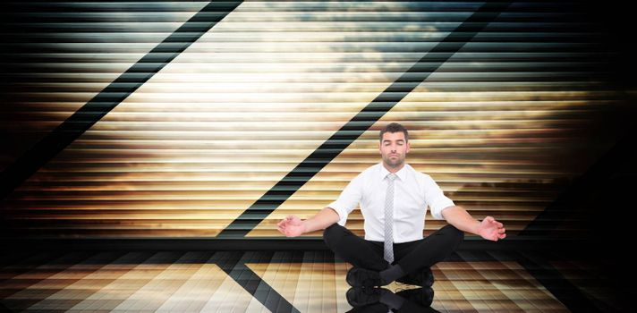 Businessman meditating in lotus pose against room with large window looking on landscape