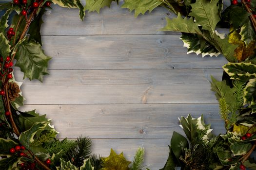 Holly twigs over wooden planks