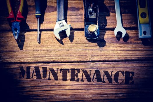 Maintenance  against desk with tools