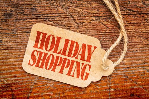 Holiday shopping  sign a paper price tag against rustic red painted barn wood