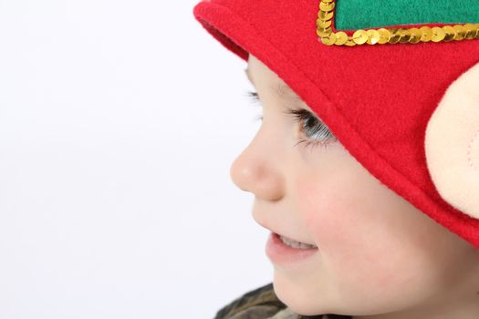 Young boy wearing a christmas elf hat