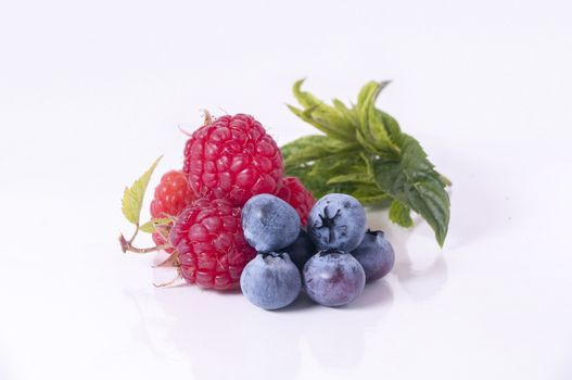 Berries and raspberry on white background
