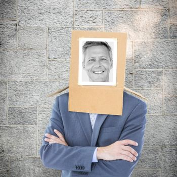 Businessman with photo box on head against grey