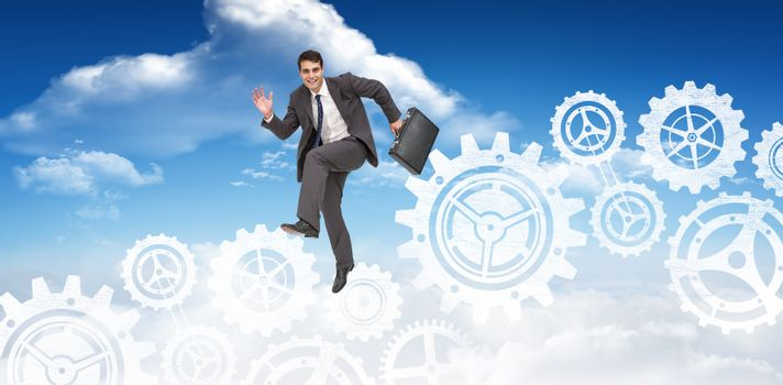 Composite image of happy businessman in a hurry