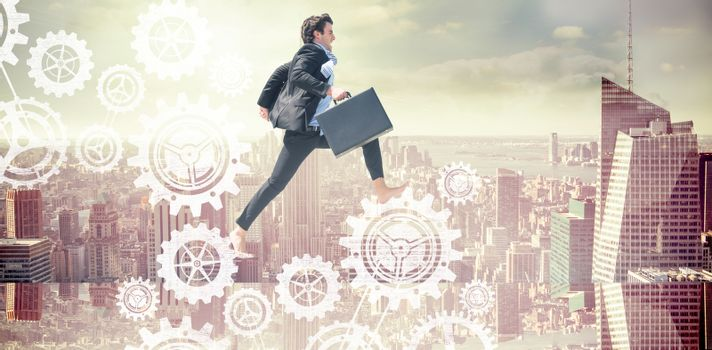 Composite image of leaping businessman