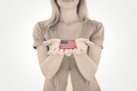 Happy blonde holding our her hands against usa national flag