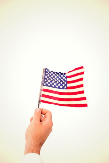 Composite image of hand waving american flag