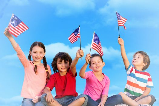 Children with american flags against sky
