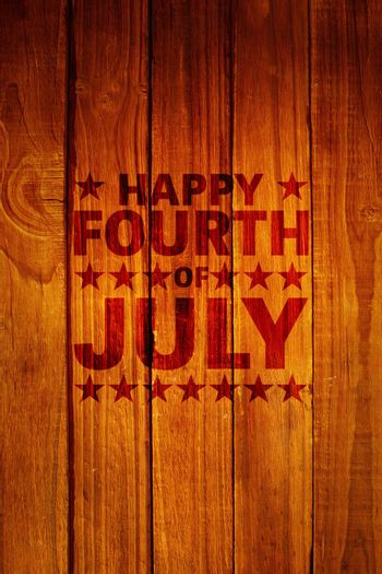 Happy fourth of july against overhead of wooden planks