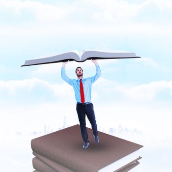Composite image of businessman in suit pushing up with effort