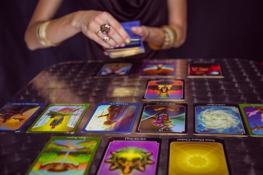 Fortune teller forecasting the future with tarot cards