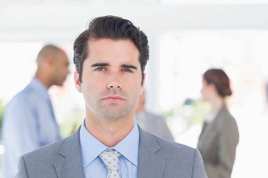 Serious businessman looking at camera