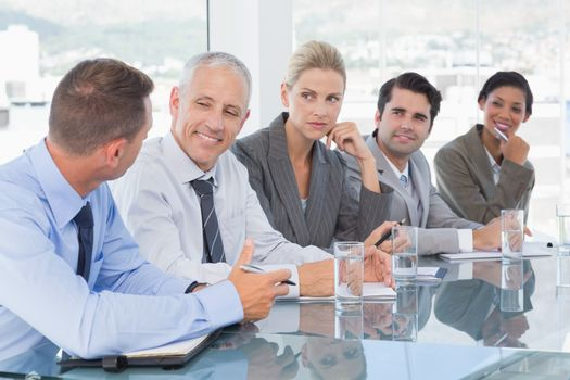 Business team having conversation at conference