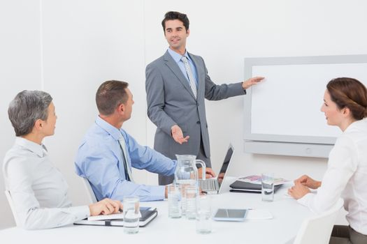 Businessman pointing the white screen