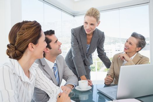 Business team working together on laptop