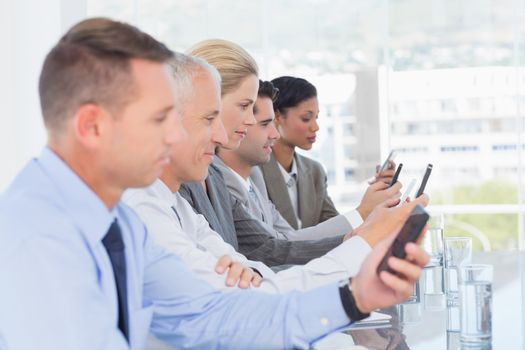 Business team using their mobile phone