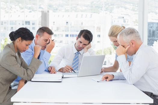 Concentrated business team working together