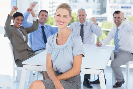 Smiling businesswoman and her team
