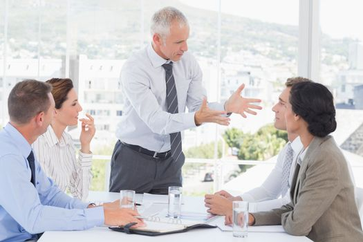 Businessman yelling at his team