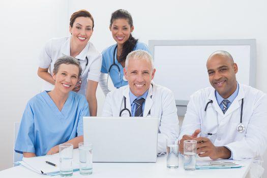 Team of doctors working on laptop