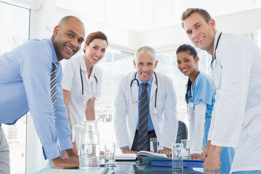 Team of smiling doctors having a meeting