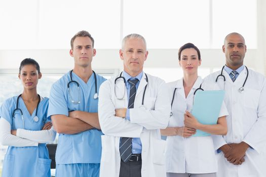 Team of smiling doctors looking at camera