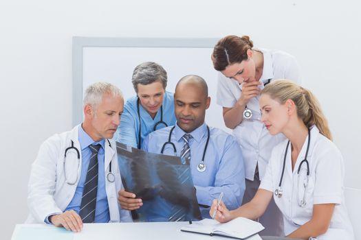 Team of doctors analyzing xray