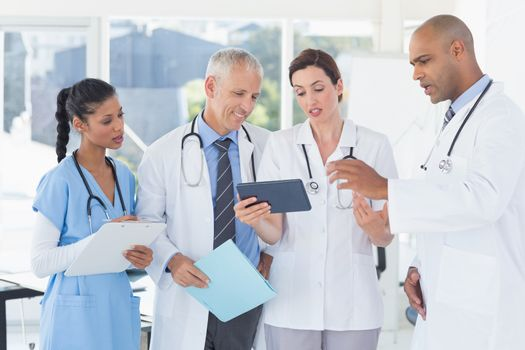 Team of doctors working together on patients file