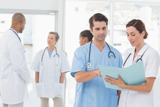 Team of doctors working on their files